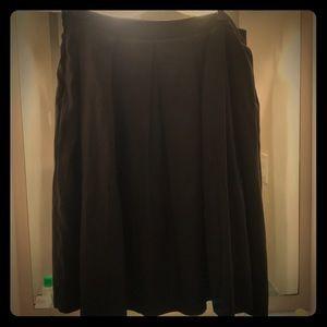 Black knee length box pleat skirt